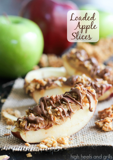 Peanut Butter, Granola, and Chocolate atop a sweet slice of apple. #easy #healthy #snack highheelsandgrills.com