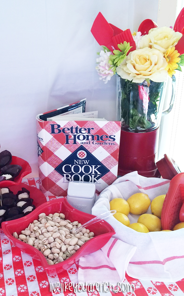 Blender with bouquet of flowers and kitchen tools Kitchen Themed Bridal Shower